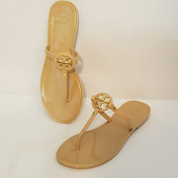 2805bb80a0be44 Tory Burch Nude Mini Miller Jelly Thong Sandal. M 5ad919c846aa7c65fa4251a6